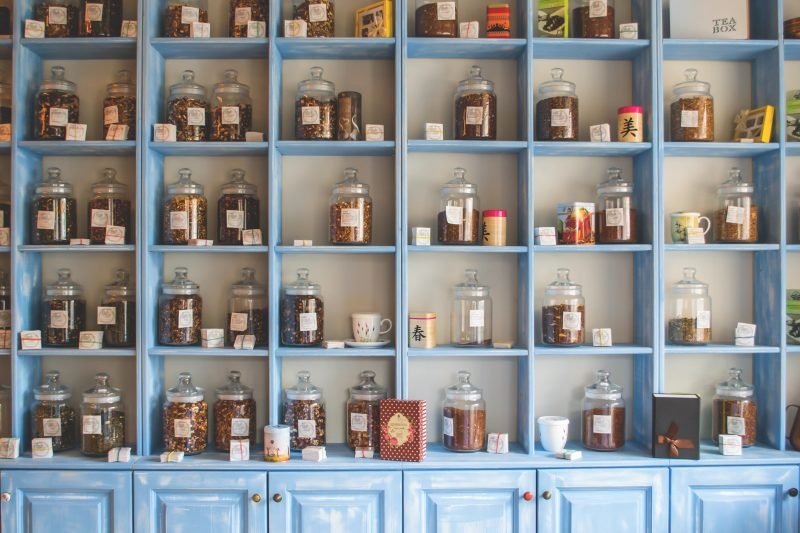 blue wooden cabinets with lollies